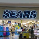 SEARS NARROWS LOSS BUT SALES TUMBLE FOR 24TH STRAIGHT QUARTER